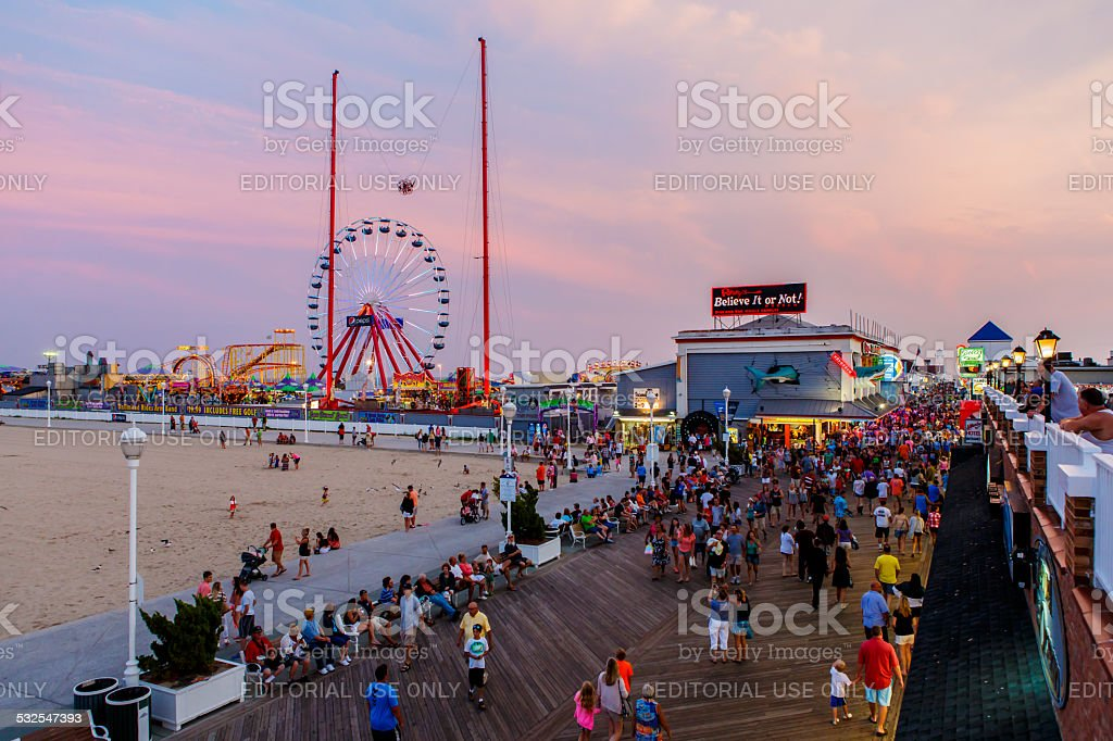 Crowded boardwalk in Ocean City, MD stock photo