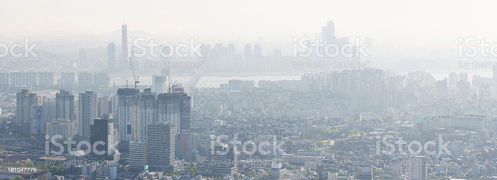 Crowded cityscape smoggy skyscraper sunrise Seoul South Korea stock photo