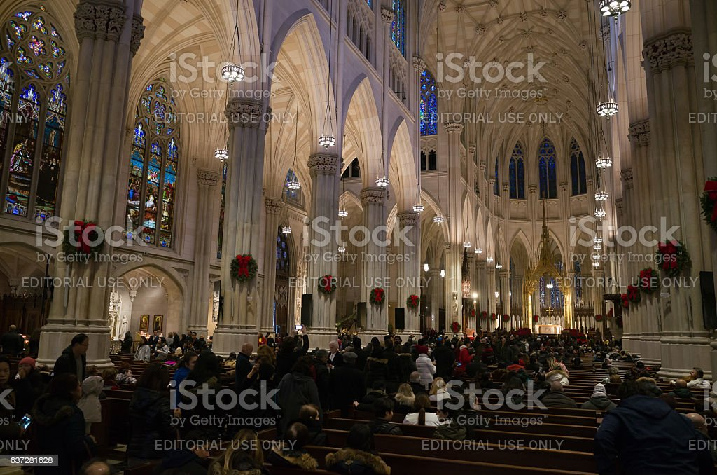 Crowded dark interior of St Patrick's cathedral on christmas day stock photo