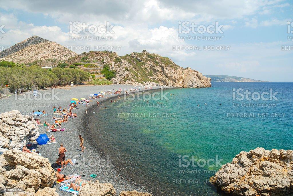Crowded Emporios Mavros Gialos beach on Chios stock photo