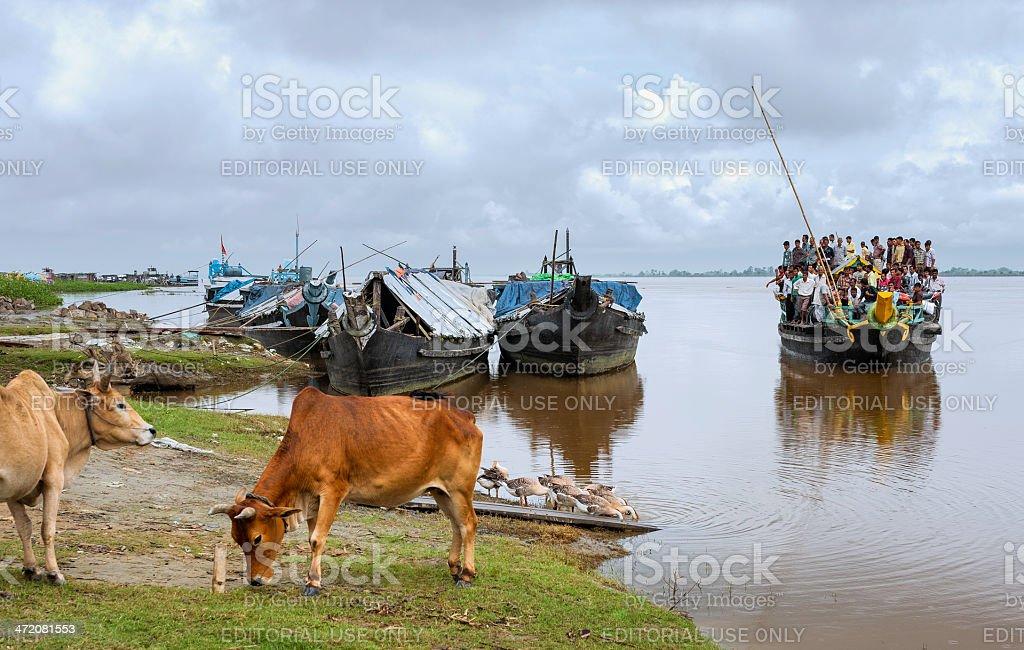 Crowded ferry on Brahmaputra river, Jorhat, Assam, India. stock photo