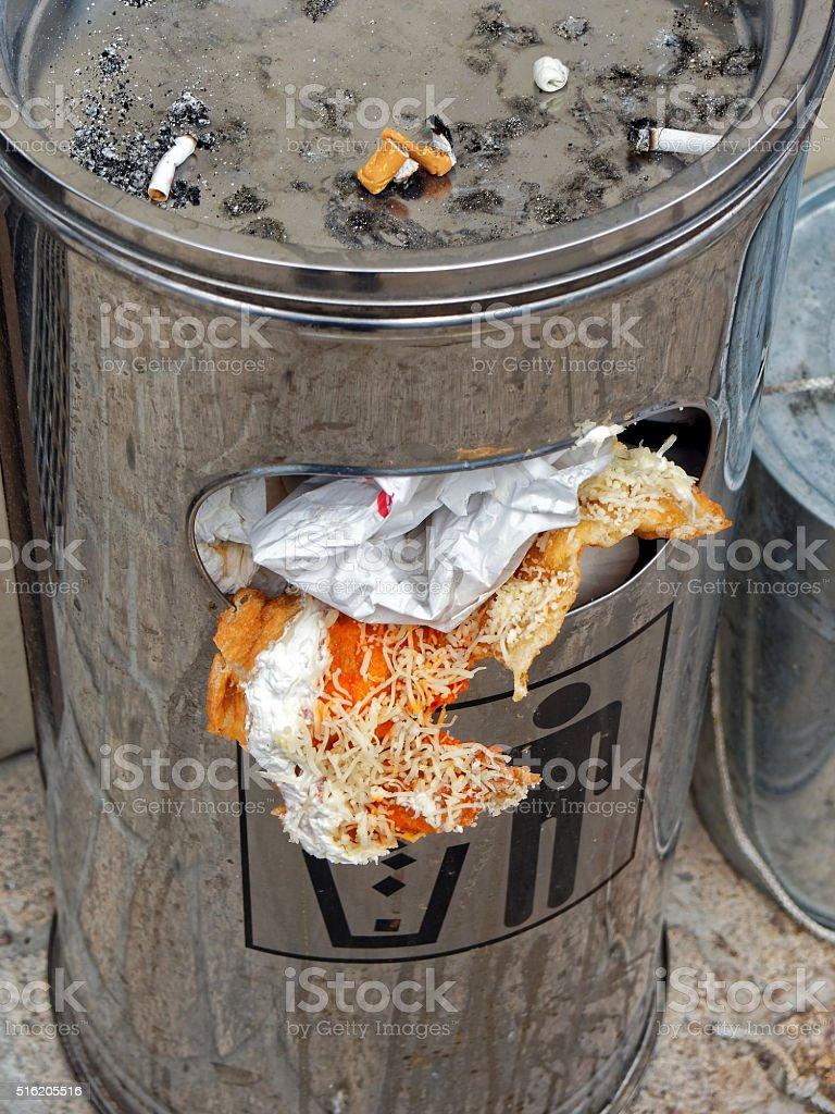 crowded garbage bin stock photo