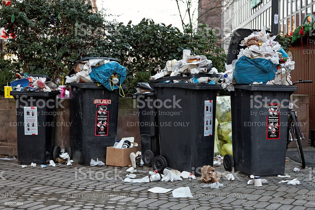 crowded garbage can stock photo