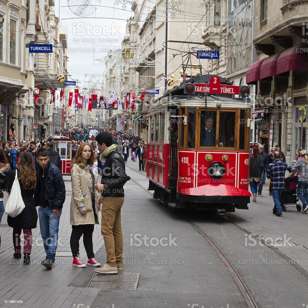 Crowded main street in Istanbul with red tram stock photo