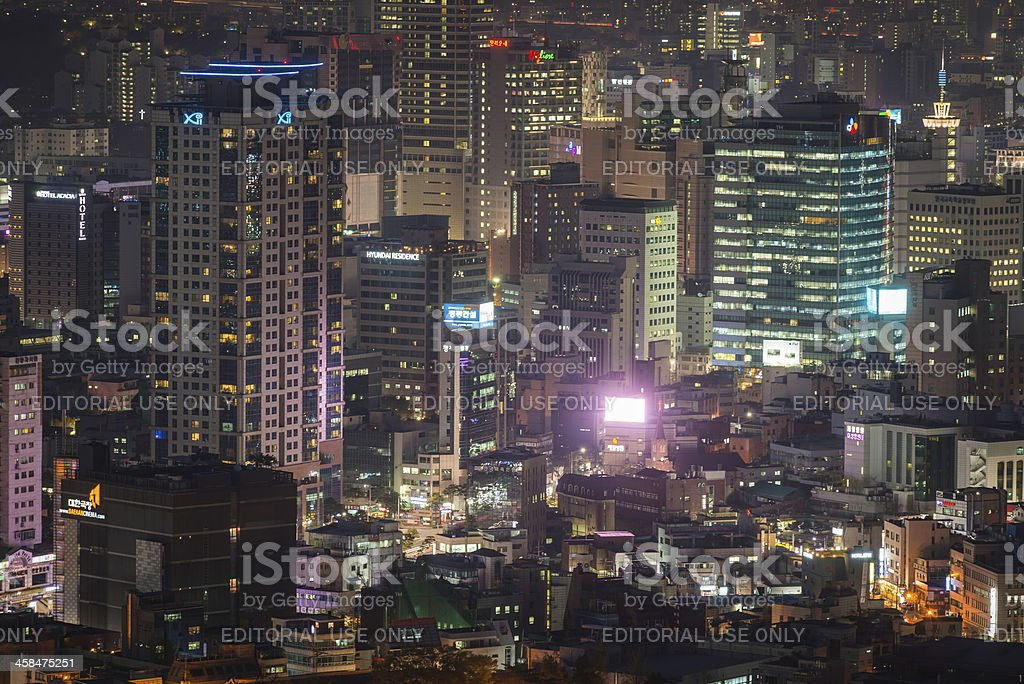 Crowded neon cityscape illuminated skyscrapers and rushing traffic Seoul Korea stock photo