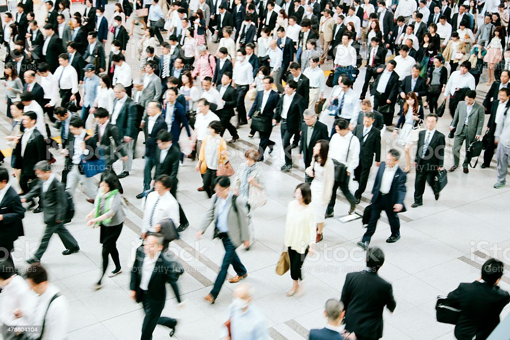 Crowded pedestrian walkway, business people, Tokyo stock photo