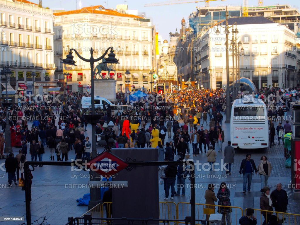 Crowded Puerta del Sol in sunny day stock photo