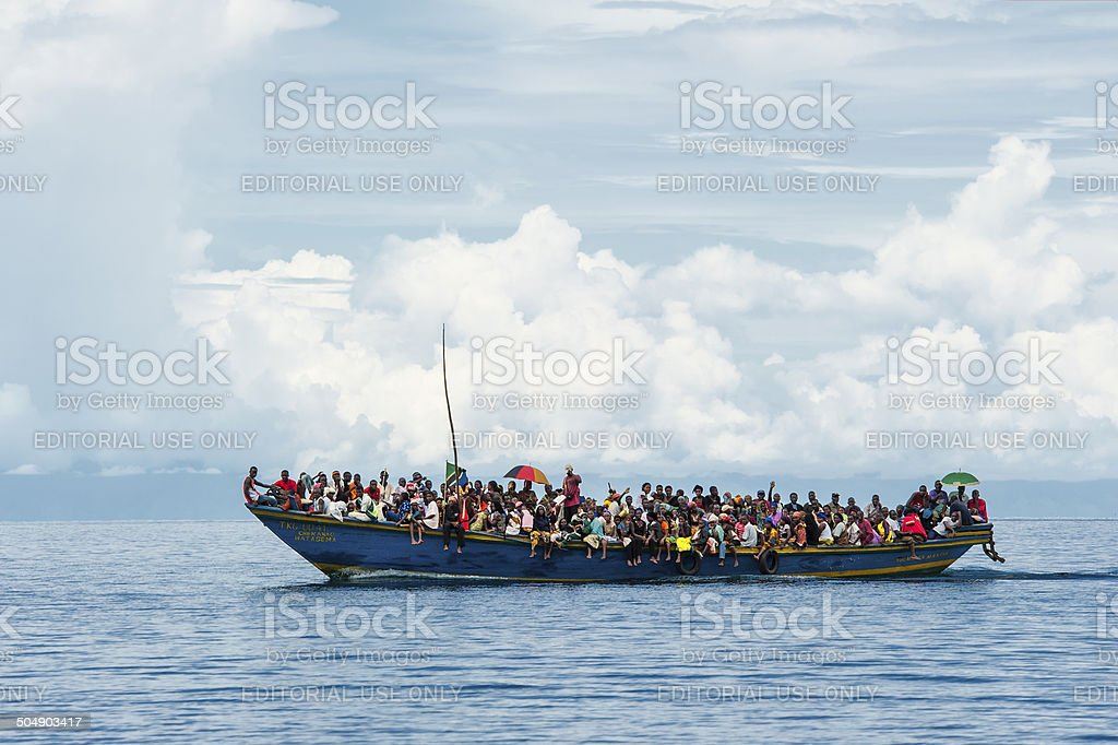 Crowded refugee boat on Lake Tanganyika stock photo