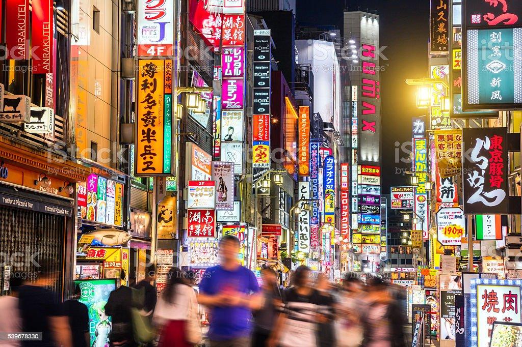 Crowded Shinjuku shopping district in Tokyo, Japan stock photo