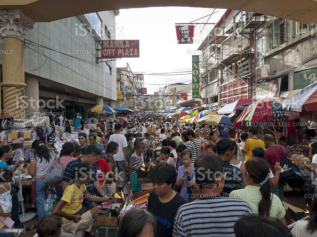 Crowded street market in Manlia, Philippine royalty-free stock photo