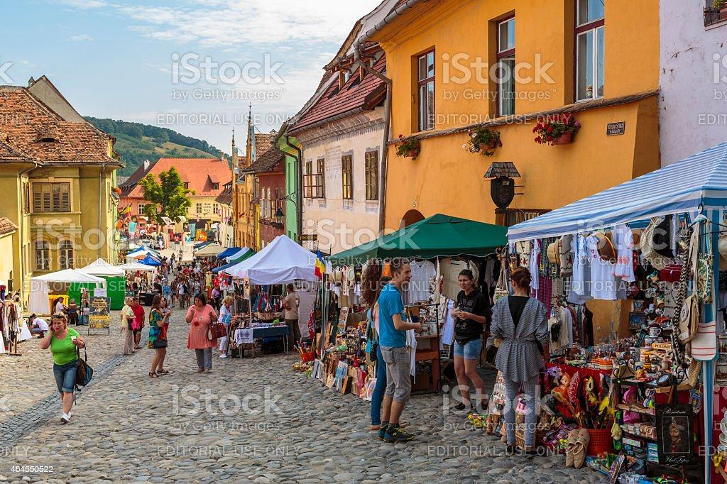 Crowded street, Sighisoara, Romania stock photo
