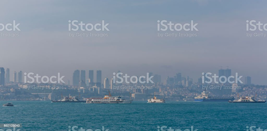 crowded traffic of traditional passenger boats and ferries at bosphorus istanbul turkey stock photo