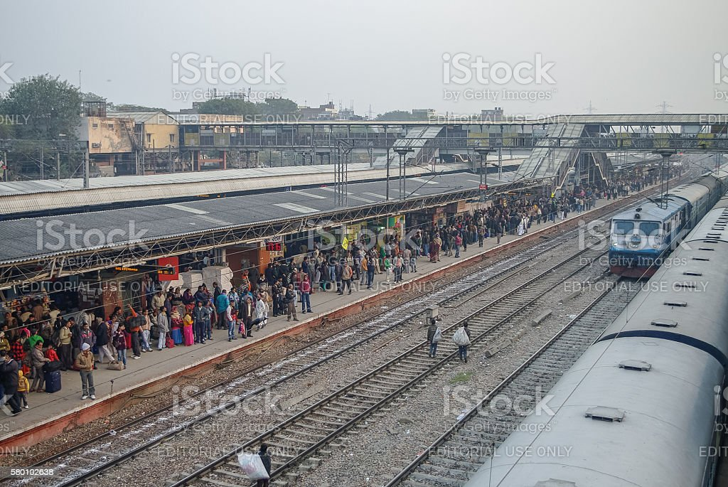 Crowded train platform in New Delhi railway station. stock photo