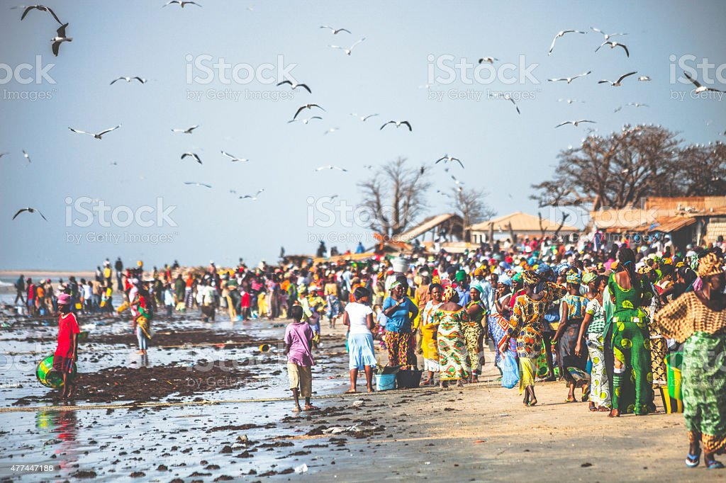 Crowded West African fish market at the beach. stock photo