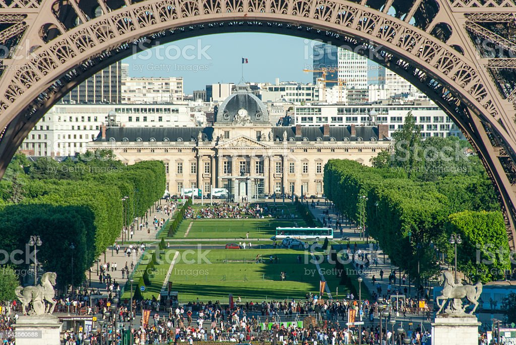 Crowds Beneath the Eiffel Tower Arches stock photo