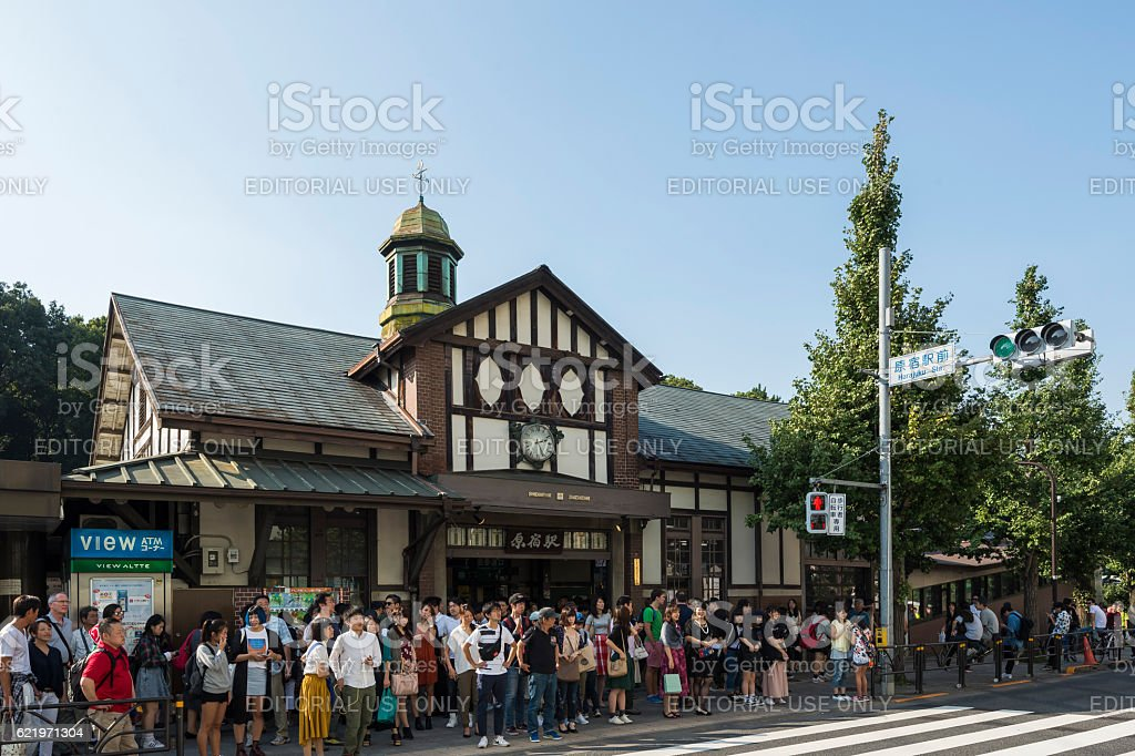 Crowds crossing the road in front of Harajuku Station stock photo