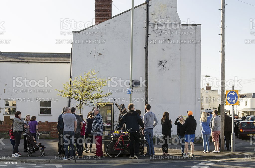 Crowds gathered around a possible Banksy artwork, Cheltenham stock photo
