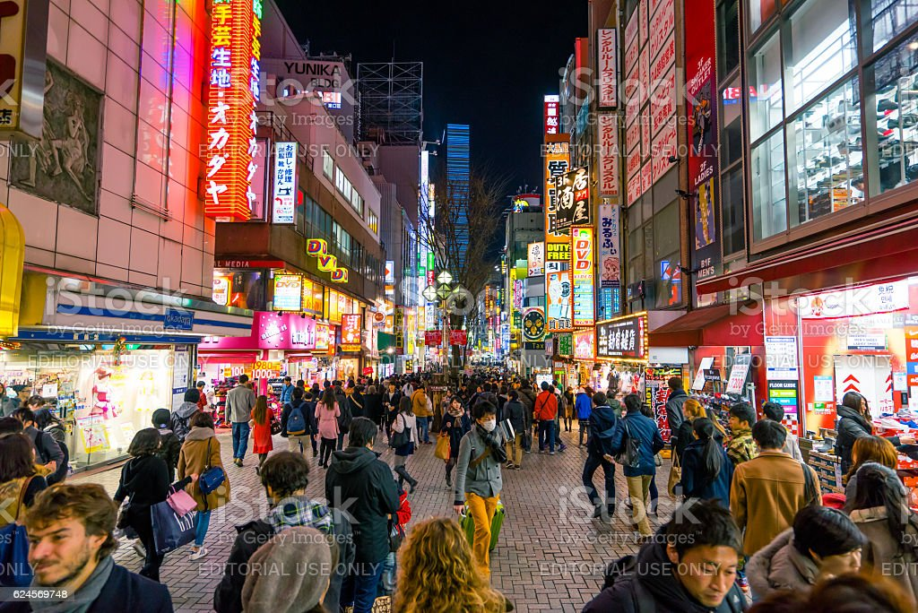 Crowds in Shijuku area with colored billboards at night stock photo