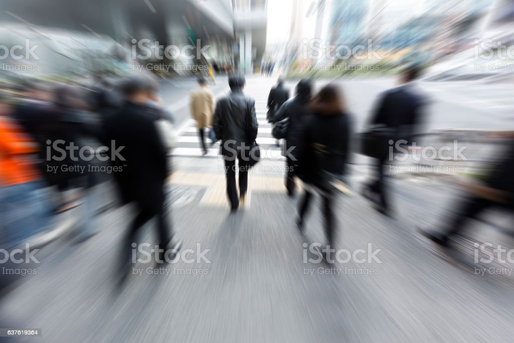Crowds of Commuters Walking Through Pedestrian Walkway in the Morning stock photo