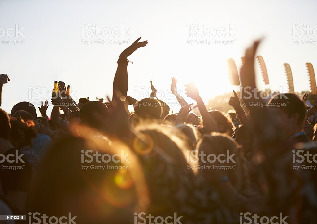 Crowds of people at outdoor music festival stock photo