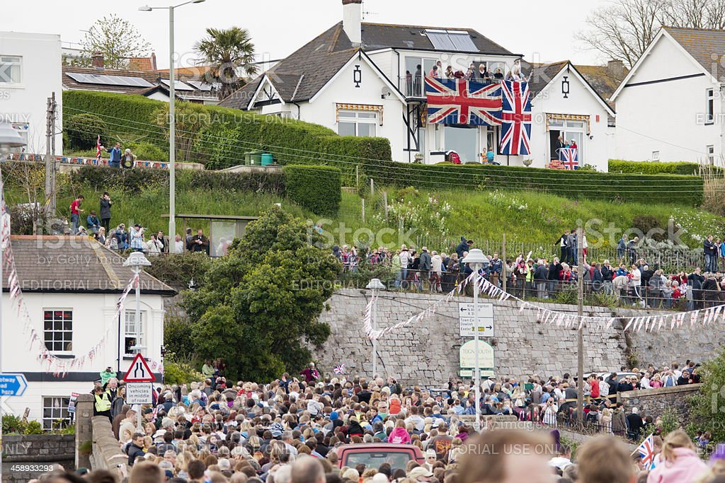 Crowds of people exiting Shaldon bridge after Olympic flame procession royalty-free stock photo