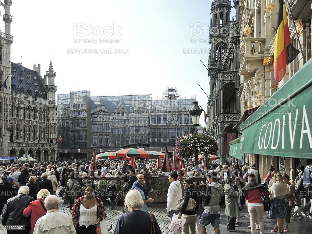 crowds of people on Grand Place in City of Brussel stock photo