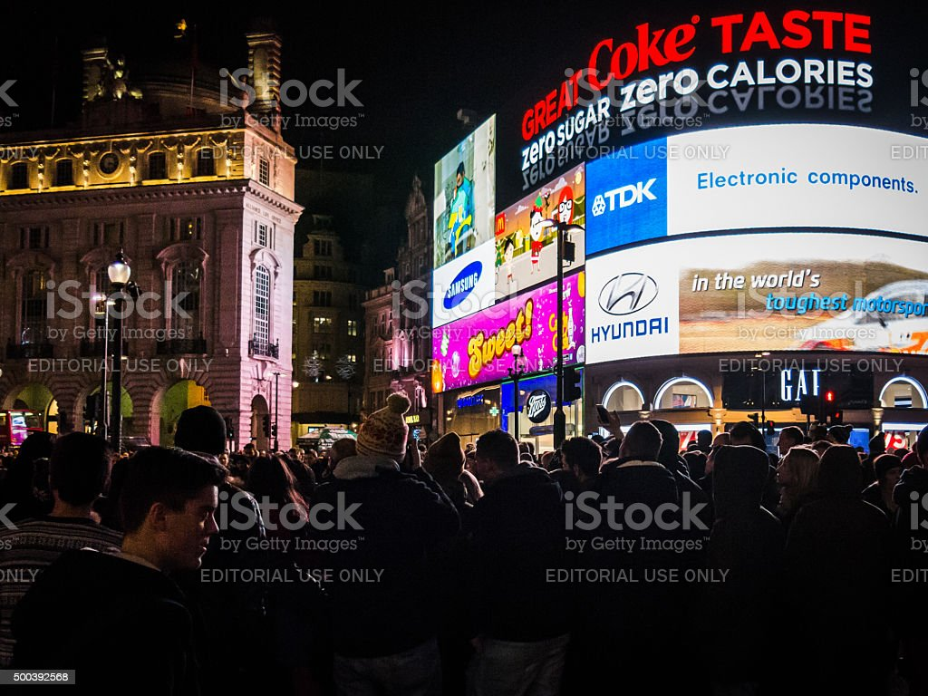 Crowds of people visit Piccadilly Circus at night stock photo