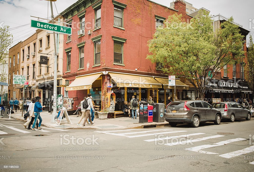 Crowds of people walking along Bedford Avenue in Williamsburg stock photo