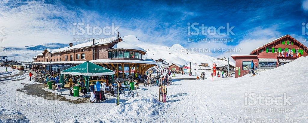 Crowds of skiers at Kleine Scheidegg winter resort Alps Switzerland stock photo