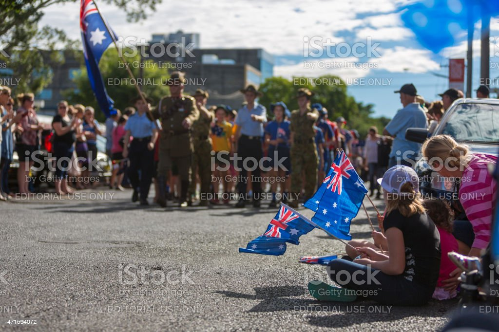 Crowds of Spectators Watch the March on ANZAC Day stock photo