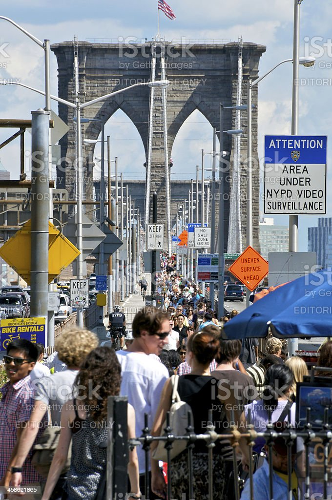 Crowds of tourists at Brooklyn Bridge walkway, Manhattan side, NYC stock photo