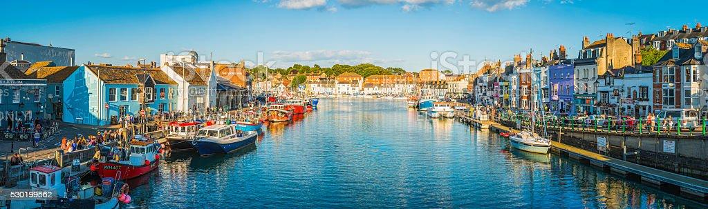 Crowds of tourists enjoying waterfront bars restaurants panorama Weymouth Dorset stock photo