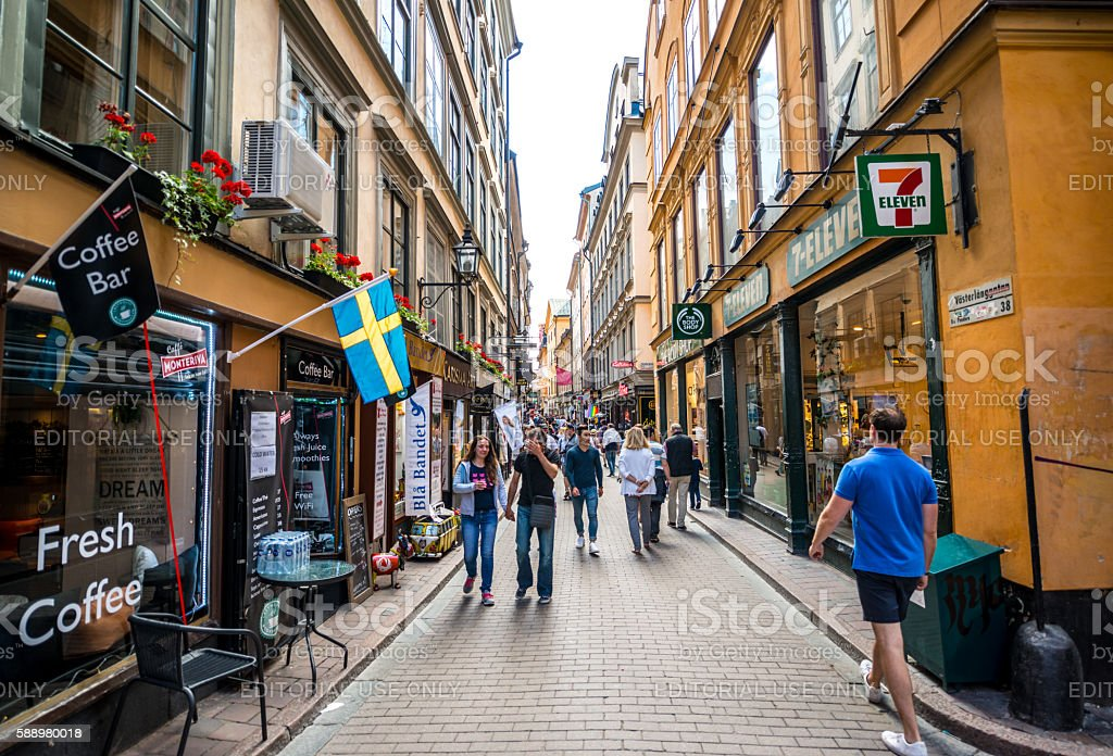 Crowds of tourists exploring Gamla Stan, Stockholm, Sweden stock photo