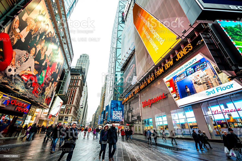 Crowds of tourists exploring Times square  during winter holiday stock photo