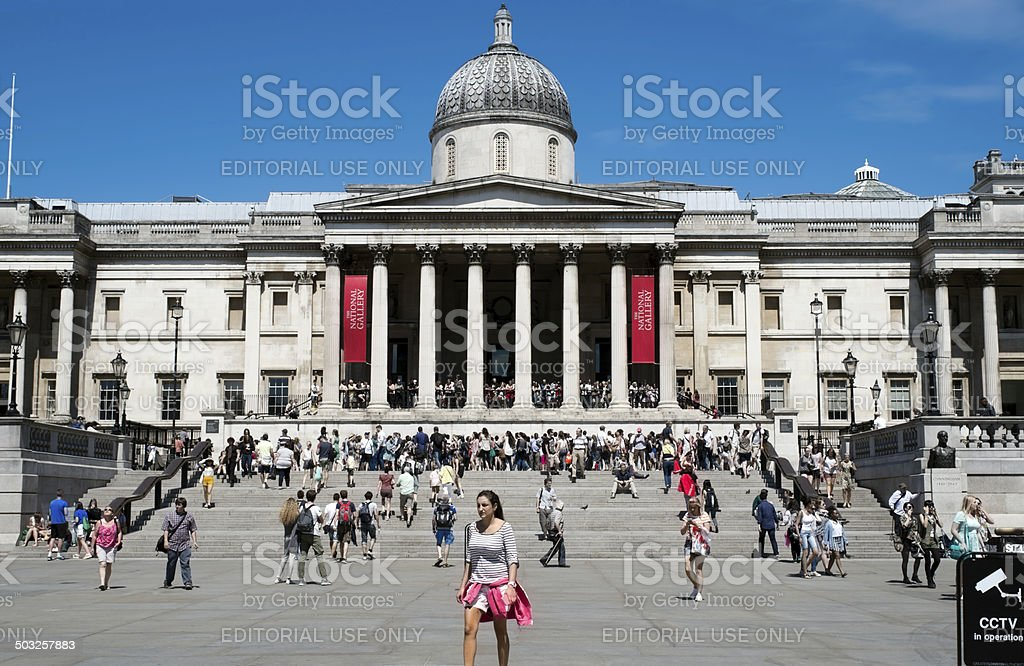 Crowds of tourists in Trafalgar Square stock photo