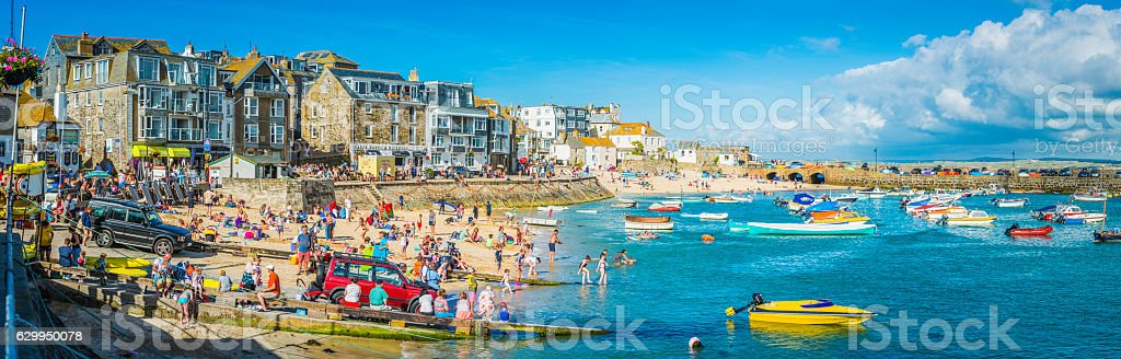 Crowds of tourists on harbour beach panorama St Ives Cornwall stock photo