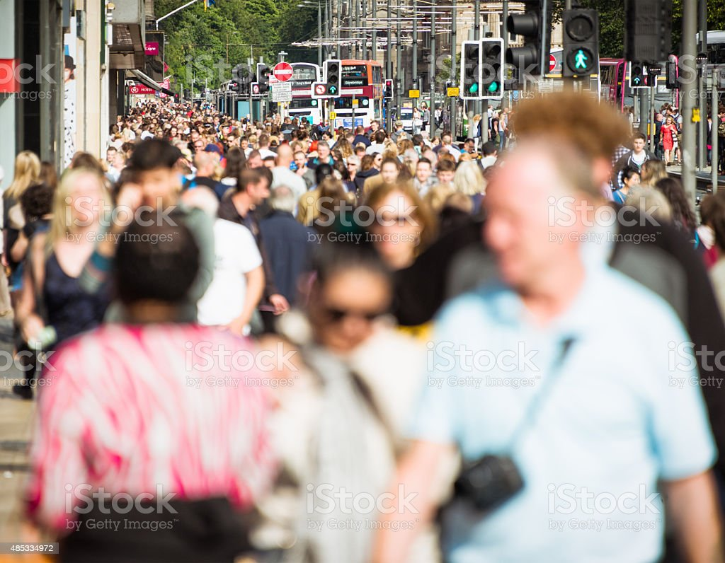 Crowds on busy British shopping street in summer stock photo