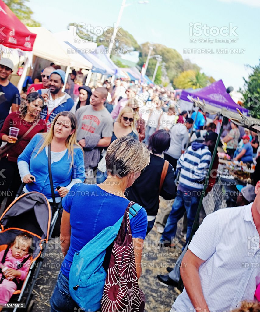 Crowds throng street carnival in Cape Town suburb stock photo