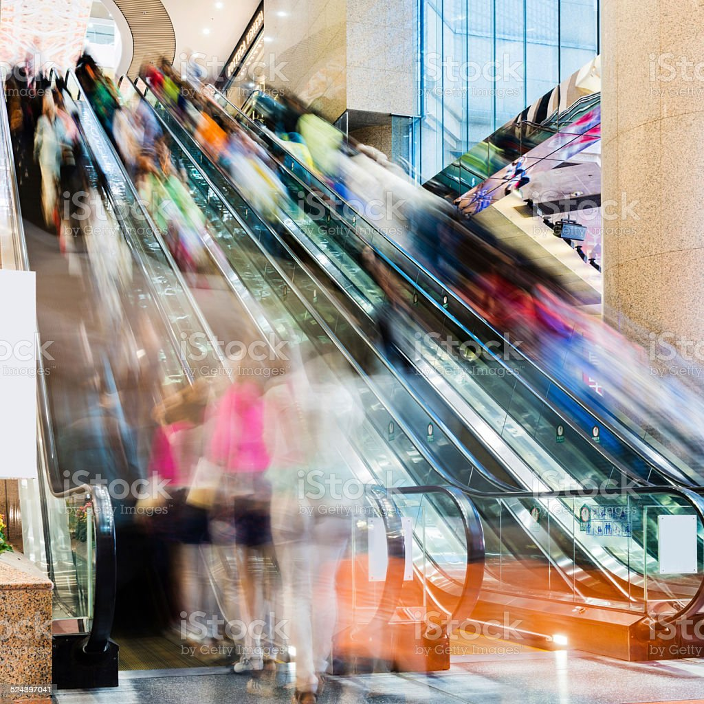 crowed escalator stock photo