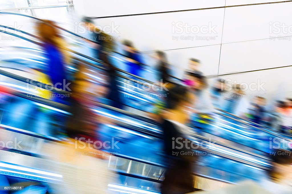 crowed escalator stock photo