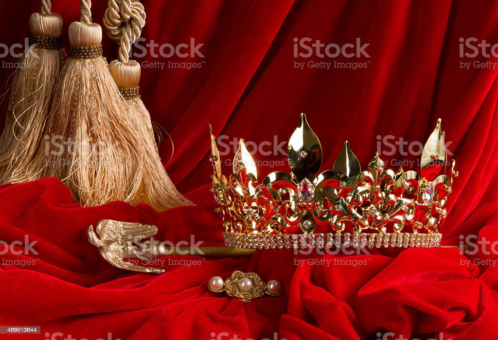 Crown and scepter on red velvet stock photo