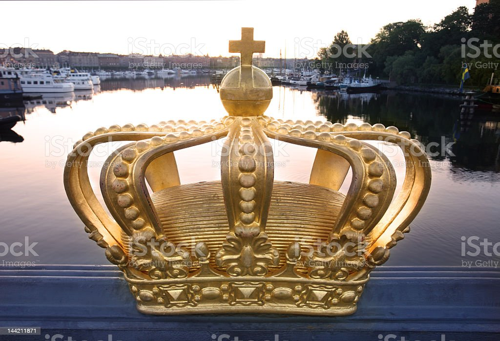 Crown bust on bridge over river in city of Stockholm royalty-free stock photo