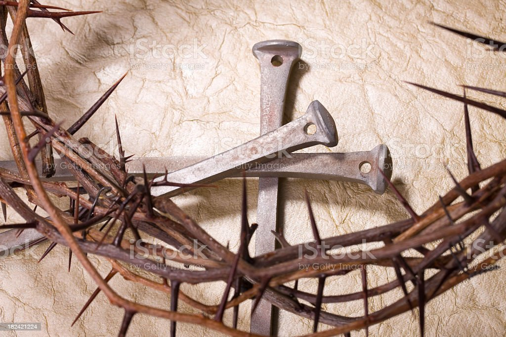 Crown of thorns and nails on textured background royalty-free stock photo