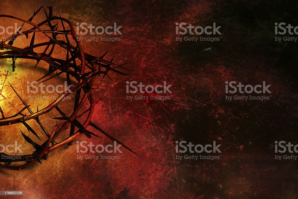 Crown of thorns on deep red grunge background stock photo