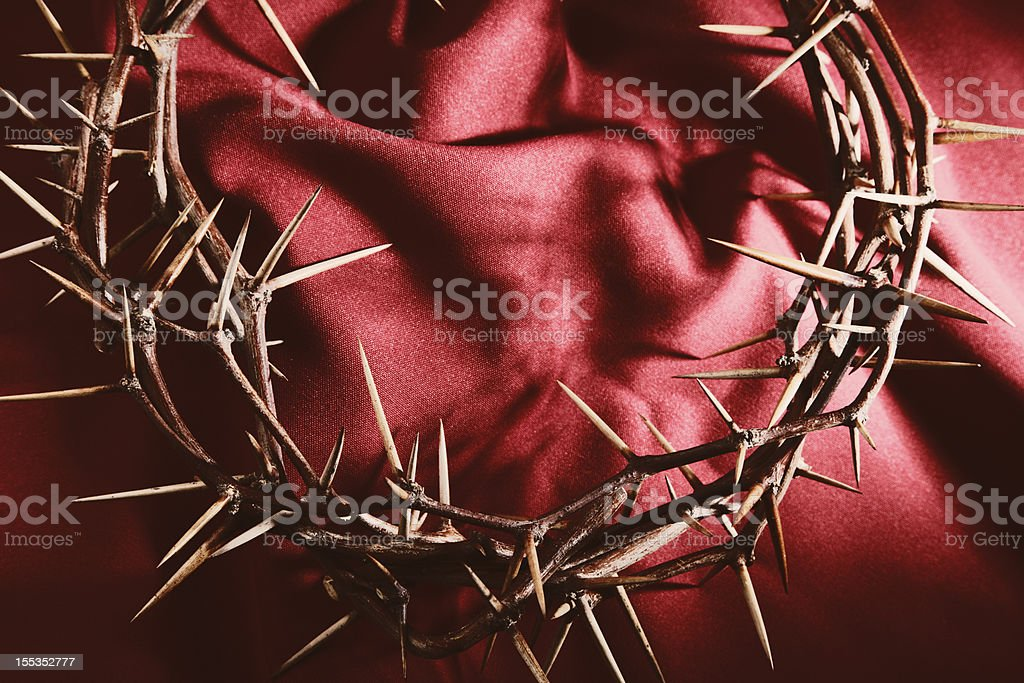 Crown of Thorns on Red Cloth Background stock photo