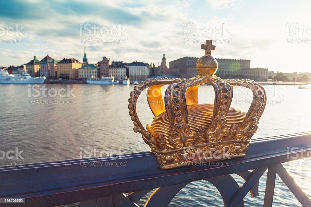 Crown on The Skeppsholm Bridge and Stockholm old town (Sweden) stock photo