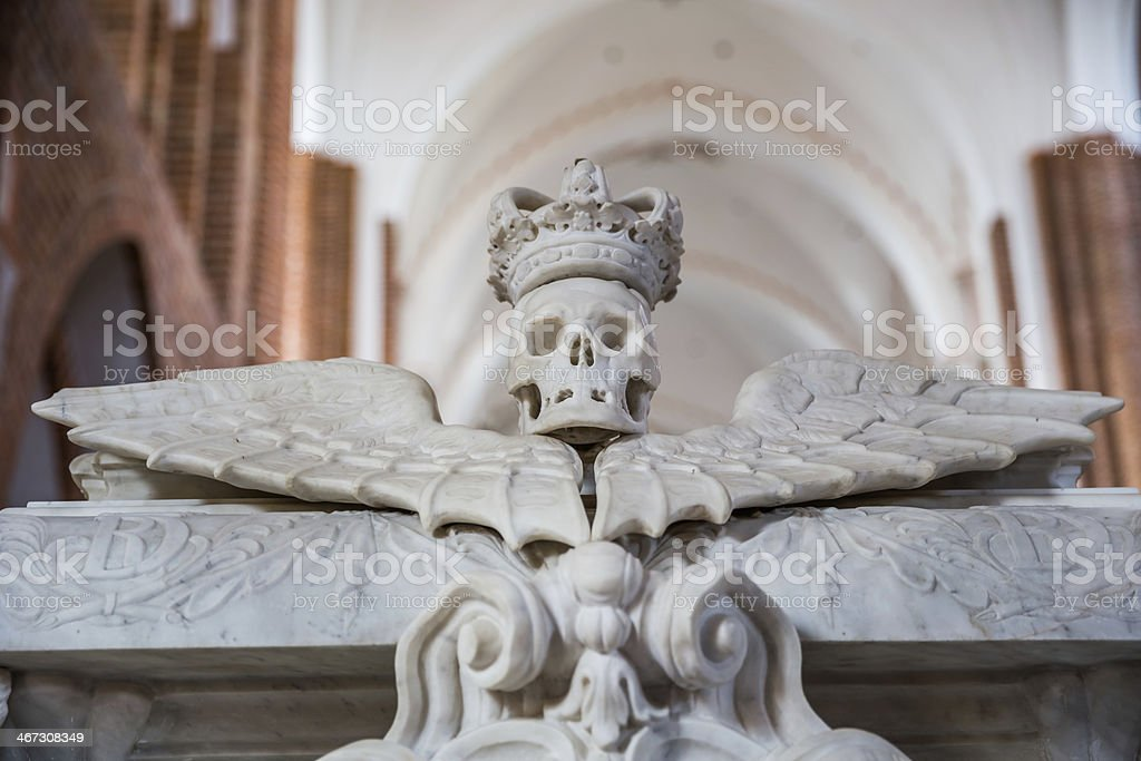 Crowned skull on sarcophagus of king Christian V, Roskilde cathedral stock photo