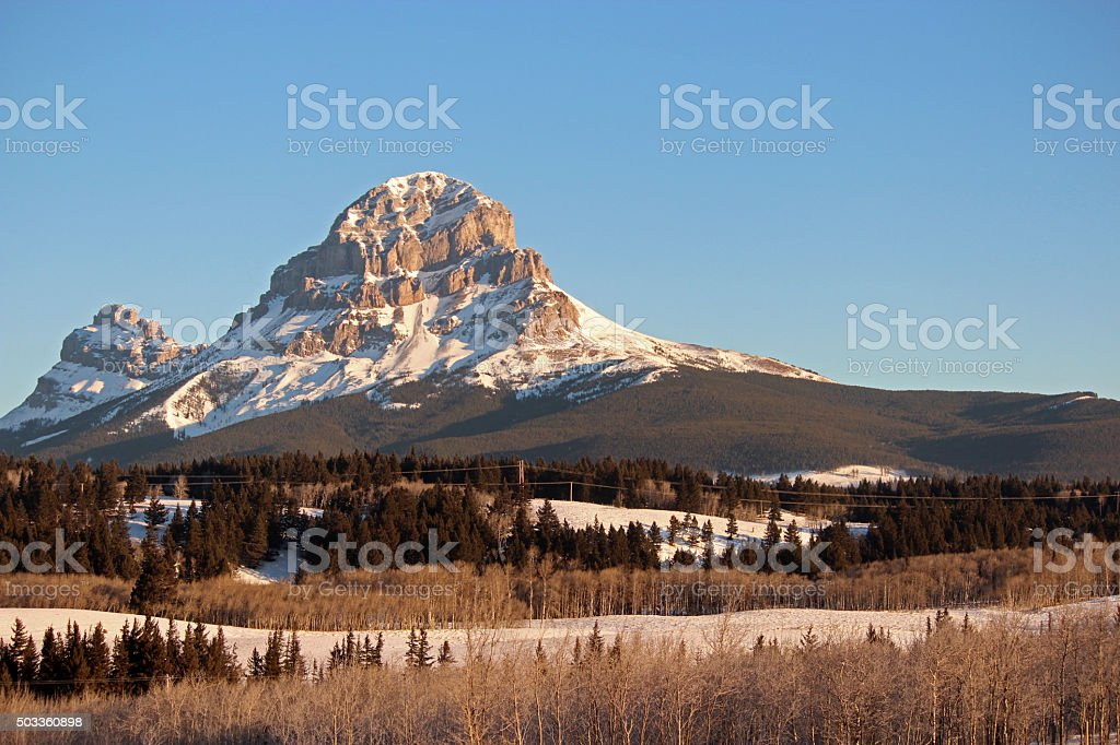 Crowsnest Mountain on Winter Morning stock photo