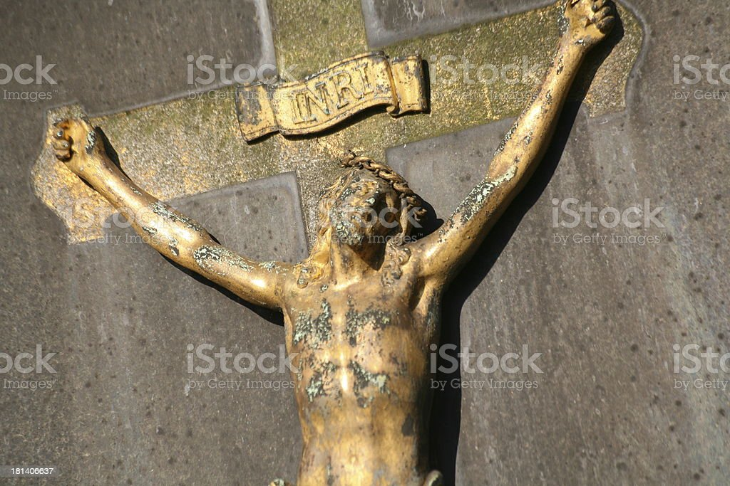Crucified on a grave stone stock photo
