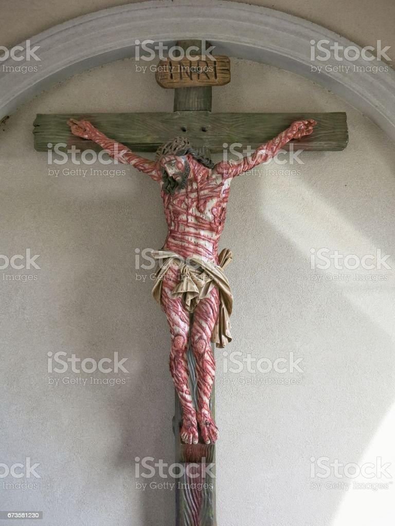 Crucified Wounded Bloody Savior Jesus Good Friday Crucifix, Light Rays stock photo